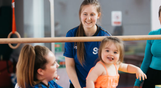 Two Coach Core apprentices work in a gymnasium