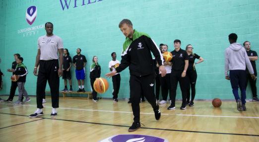 Coach Core apprentice leads a basketball session
