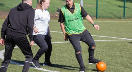 Coach Core apprentice runs a football training session